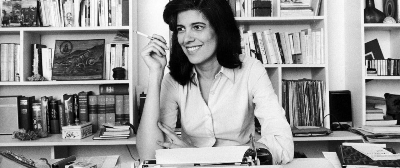 Susan Sontag behind desk